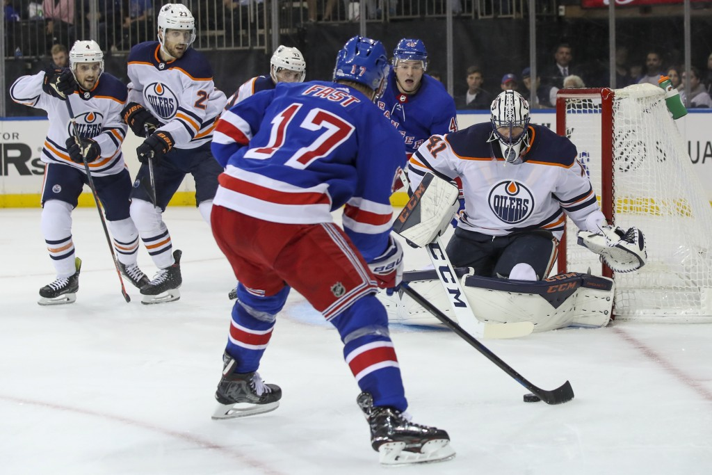 Edmonton Oilers goaltender Mike Smith (41) tends net as New York Rangers right wing Jesper Fast (17) looks for an opening in the second period of an N...