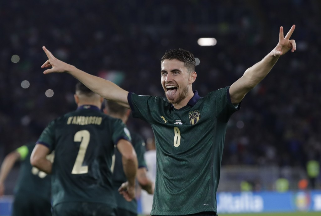 Italy's Jorginho celebrates after he scores the opening goal of the game from the penalty spot during the Euro 2020 group J qualifying soccer match be...