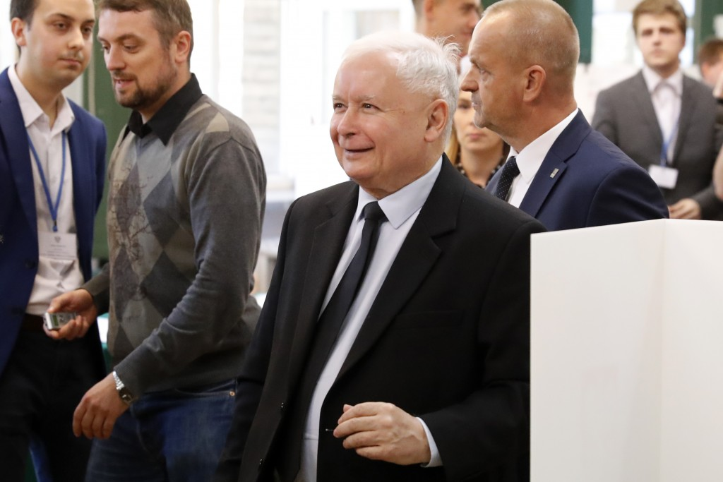 The ruling party leader Jaroslaw Kaczynski leaves polling station after his vote in Warsaw, Poland, Sunday, Oct. 13, 2019. Poles are voting Sunday in ...