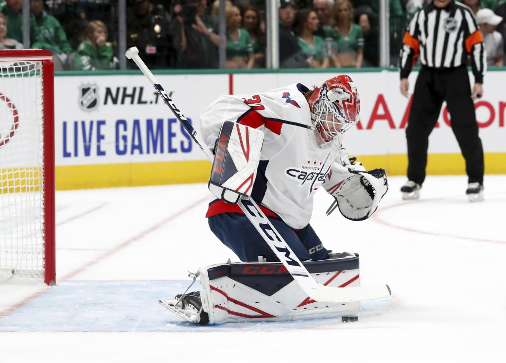Washington Capitals goaltender Ilya Samsonov (30) blocks a shot from the Dallas Stars in the first period of an NHL hockey game in Dallas, Saturday, O...