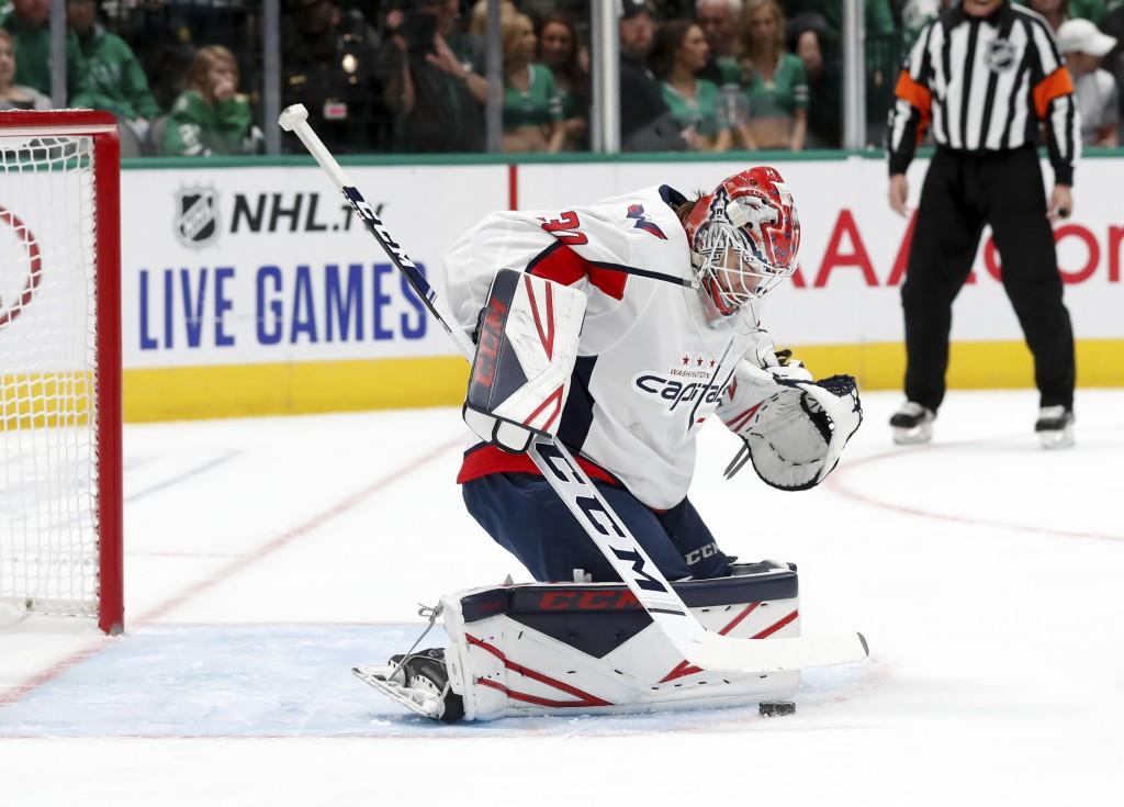 Washington Capitals goaltender Ilya Samsonov (30) blocks a shot from the Dallas Stars in the first period of an NHL hockey game in Dallas, Saturday, O