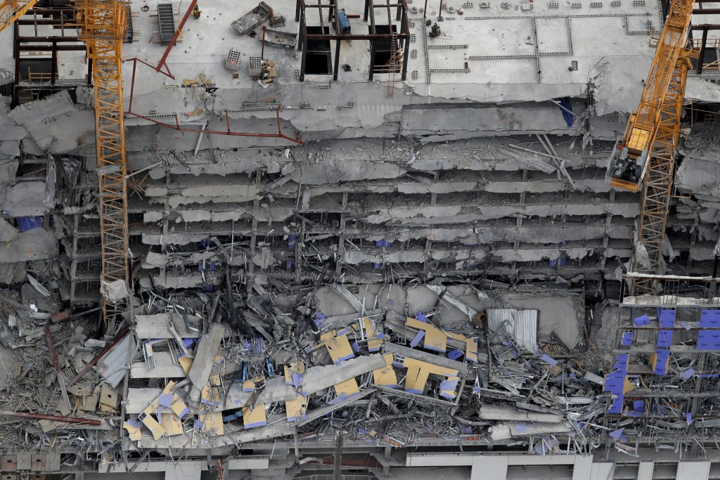 This aerial photo shows the Hard Rock Hotel, which was under construction, after a fatal partial collapse in New Orleans, Saturday, Oct. 12, 2019. (AP...