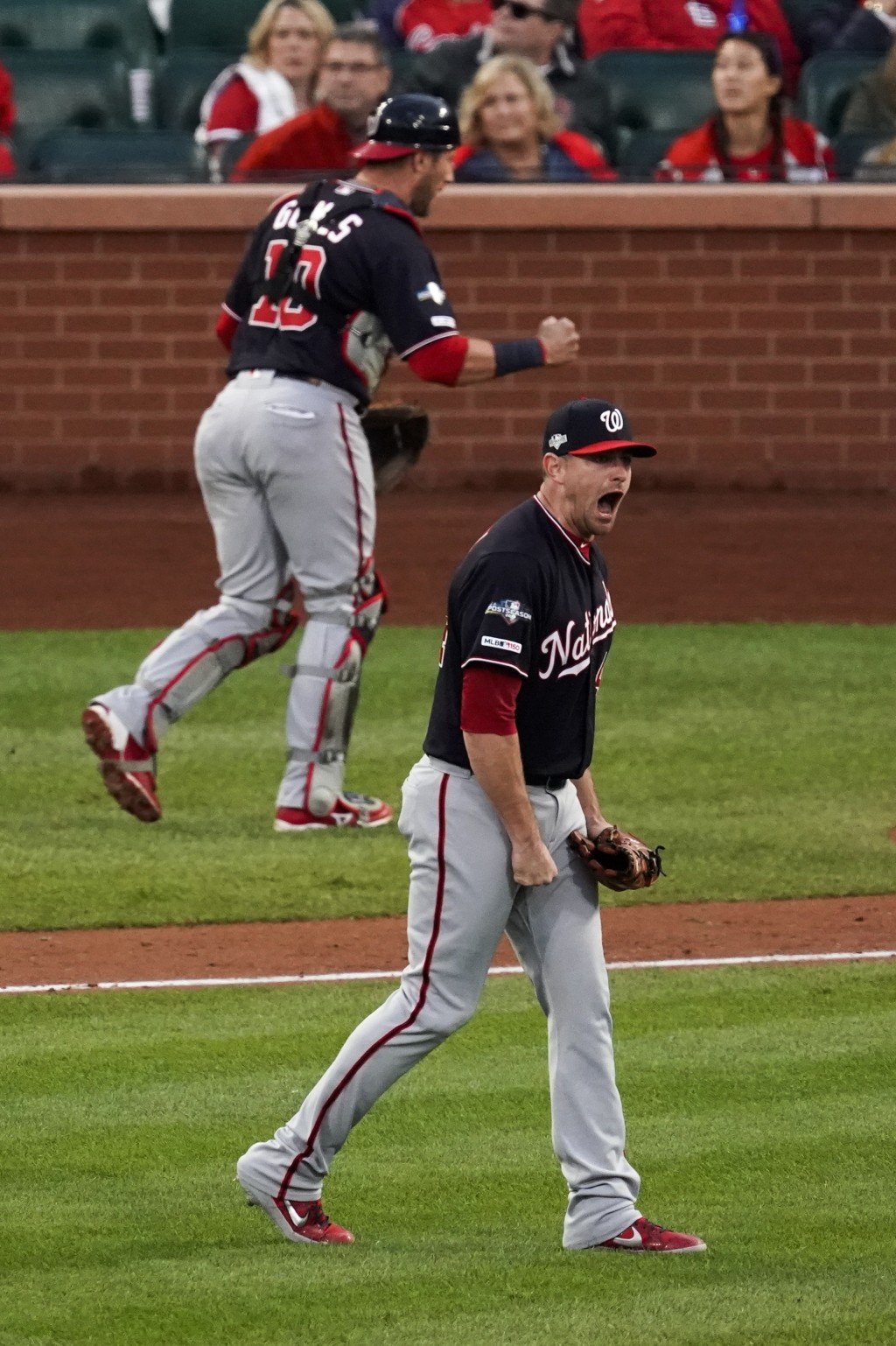 Washington Nationals' Daniel Hudson and Yan Gomes celebrate after Game 2 of the baseball National League Championship Series against the St. Louis Car
