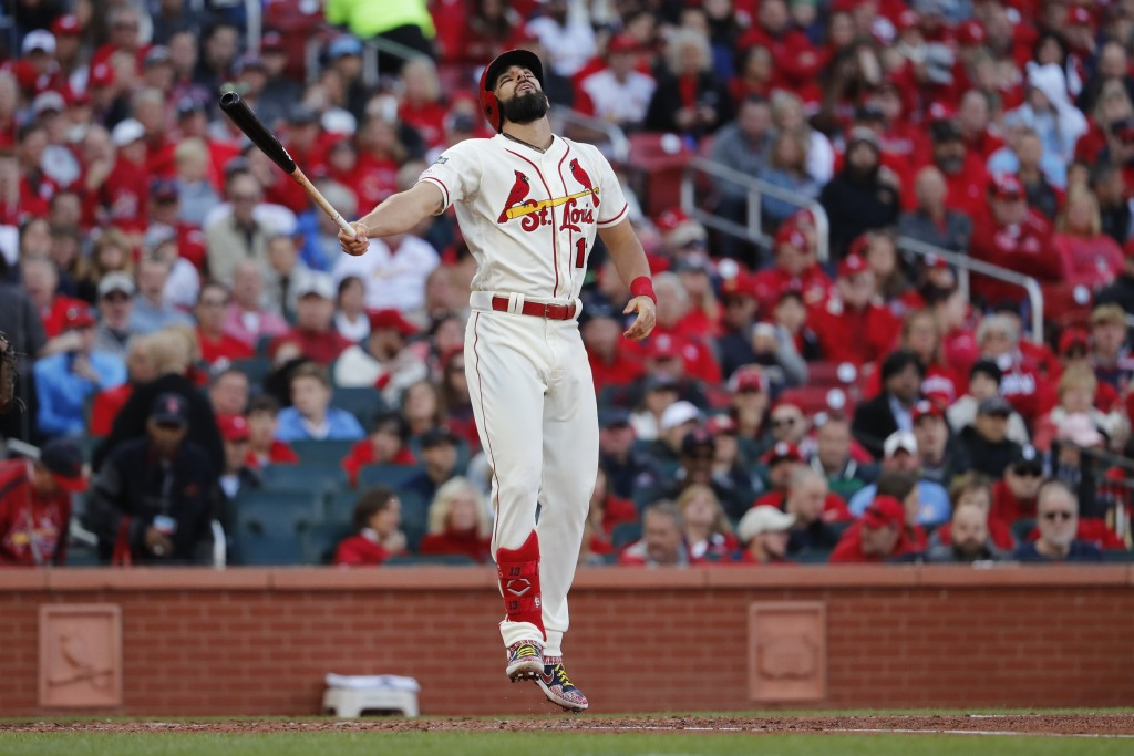St. Louis Cardinals' Matt Carpenter reacts after striking out during the fifth inning of Game 2 of the baseball National League Championship Series ag...