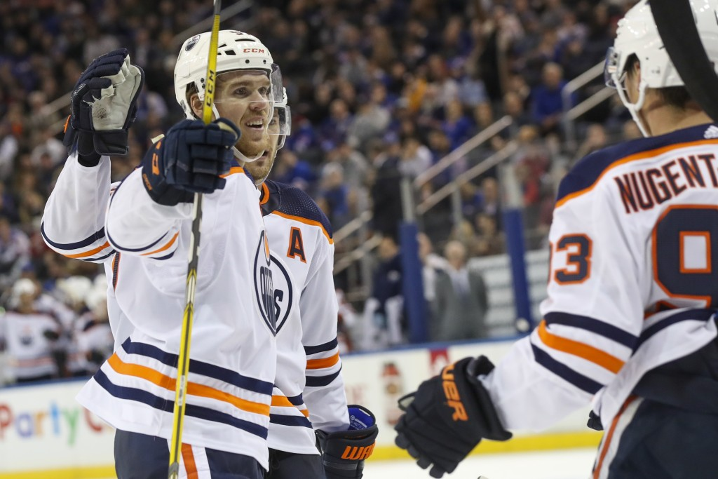 Edmonton Oilers center Connor McDavid (97) celebrates after scoring a goal against the New York Rangers during the third period of an NHL hockey game,...