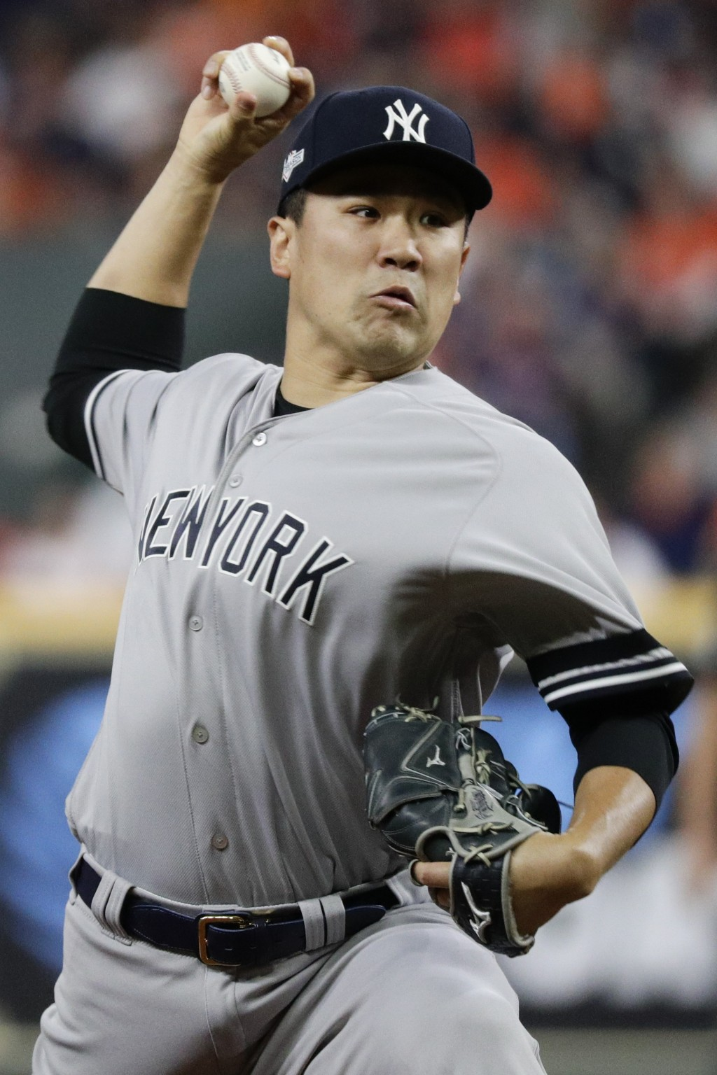 New York Yankees starting pitcher Masahiro Tanaka throws against the Houston Astros during the first inning in Game 1 of baseball's American League Ch...