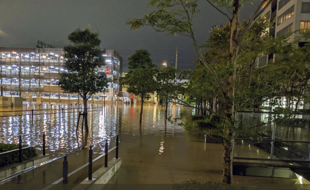 This Oct. 12, 2019 photo by @ar_kaz shows the flooded streets in Kawasaki, near Tokyo, Japan. Helicopters plucked people from their flooded homes on S...