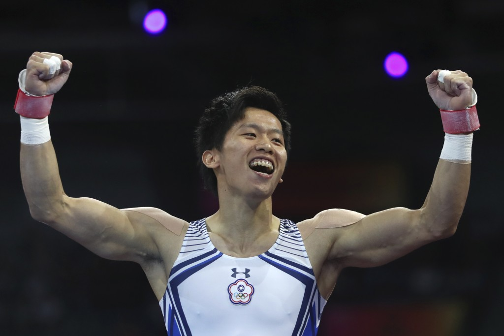 Silver medalist Lee Chih-kai of Taiwan celebrates after his performamce on the pommel horse in the men's apparatus finals at the Gymnastics World Cham