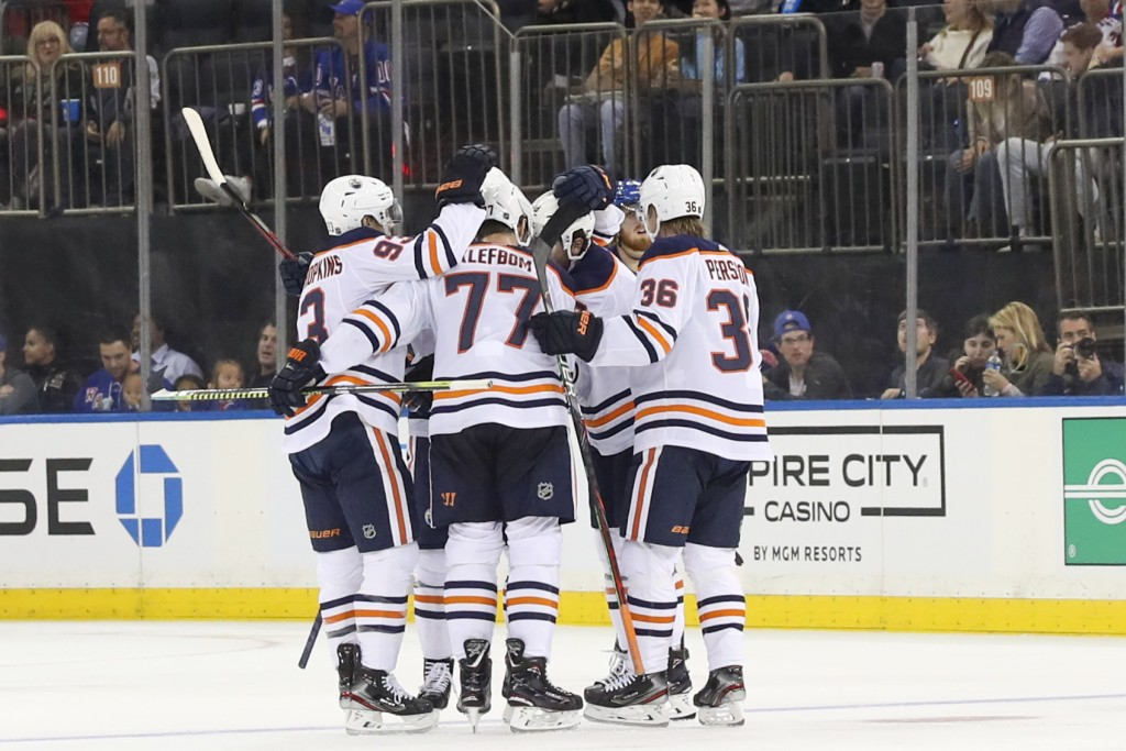 The Edmonton Oilers celebrate a goal by defenseman Oscar Klefbom (77) during the second period of an NHL hockey game against the New York Rangers, Sat...