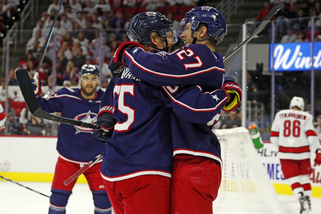 Columbus Blue Jackets' Markus Nutivaara (65), of Finland, celebrates his goal with teammate Ryan Murray (27) during the first period of an NHL hockey ...