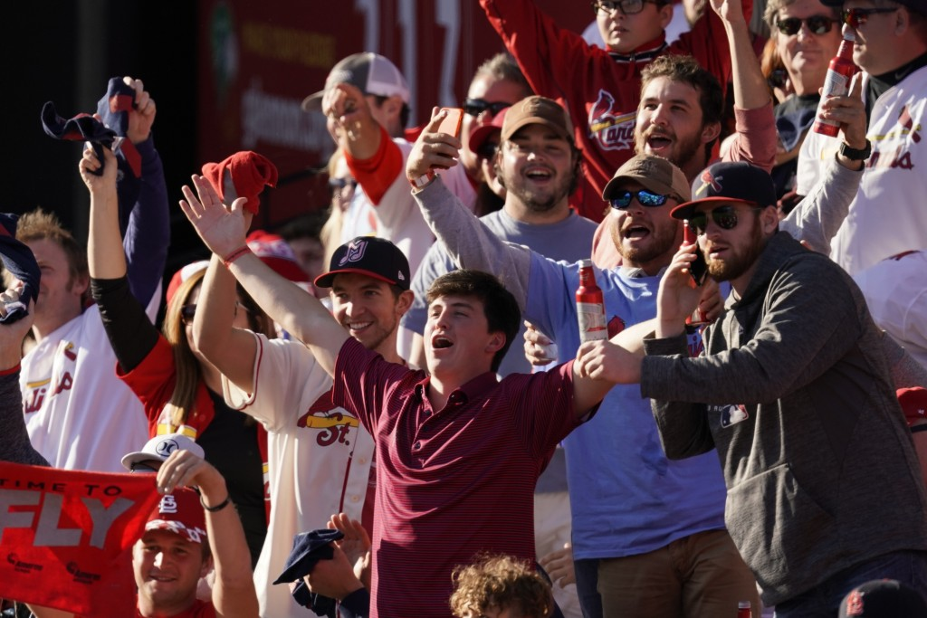 Fans cheer during the fifth inning of Game 2 of the baseball National League Championship Series between the St. Louis Cardinals and the Washington Na...
