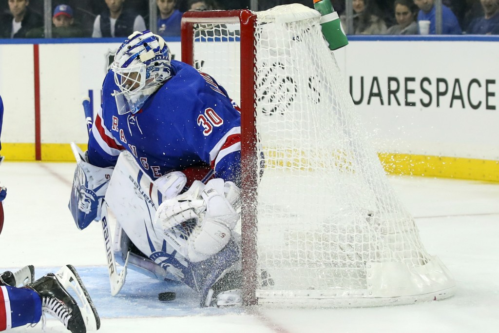 New York Rangers goaltender Henrik Lundqvist (30) is unable to stop a shot for a goal by Edmonton Oilers center Connor McDavid during the third period...