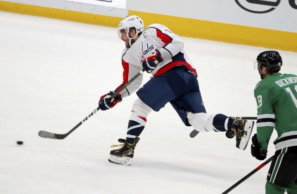 Washington Capitals left wing Alex Ovechkin (8) takes a shot in the closing seconds of the second period of an NHL hockey game as Dallas Stars center ...