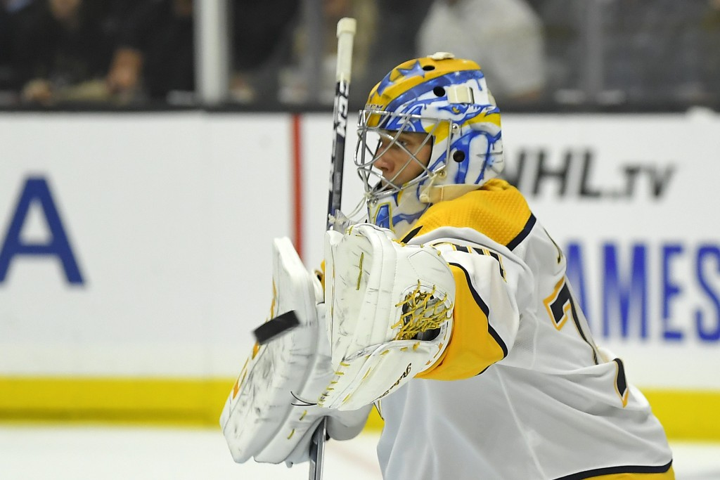 Nashville Predators goaltender Juuse Saros makes a glove save during the second period of the team's NHL hockey game against the Los Angeles Kings on