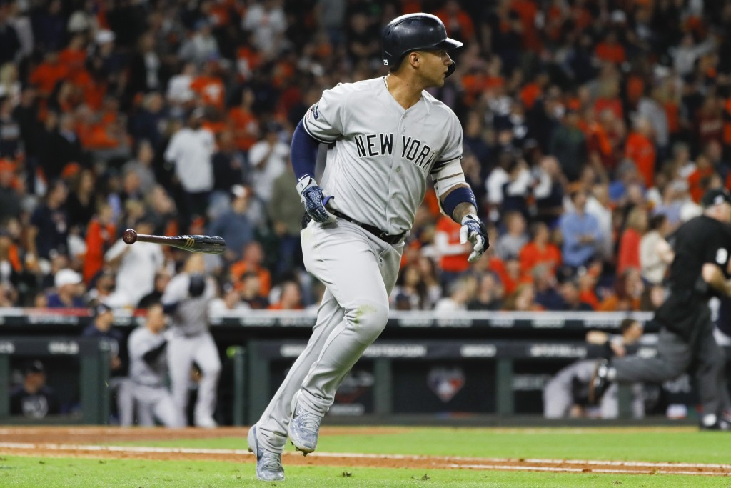 New York Yankees' Gleyber Torres rounds the bases after a run home run during the sixth inning in Game 1 of baseball's American League Championship Se...