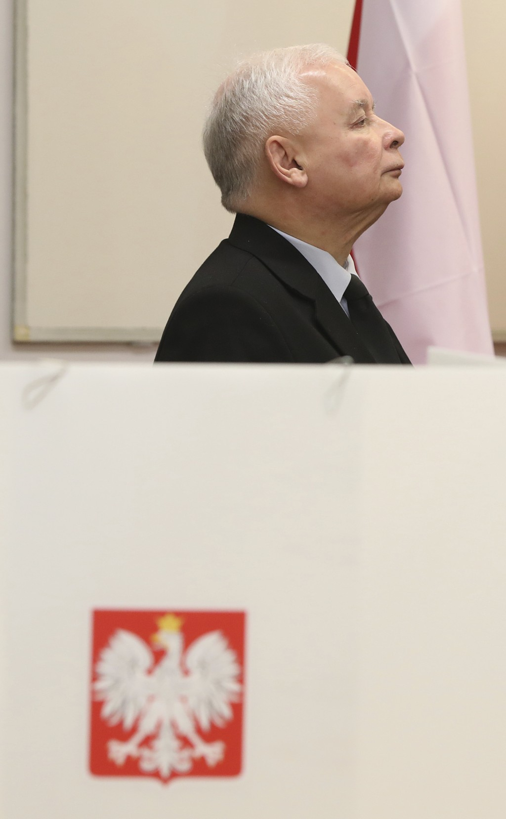 The ruling party leader Jaroslaw Kaczynski holds his ballot at a polling station in Warsaw, Poland, Sunday, Oct. 13, 2019. Poles are voting Sunday in ...