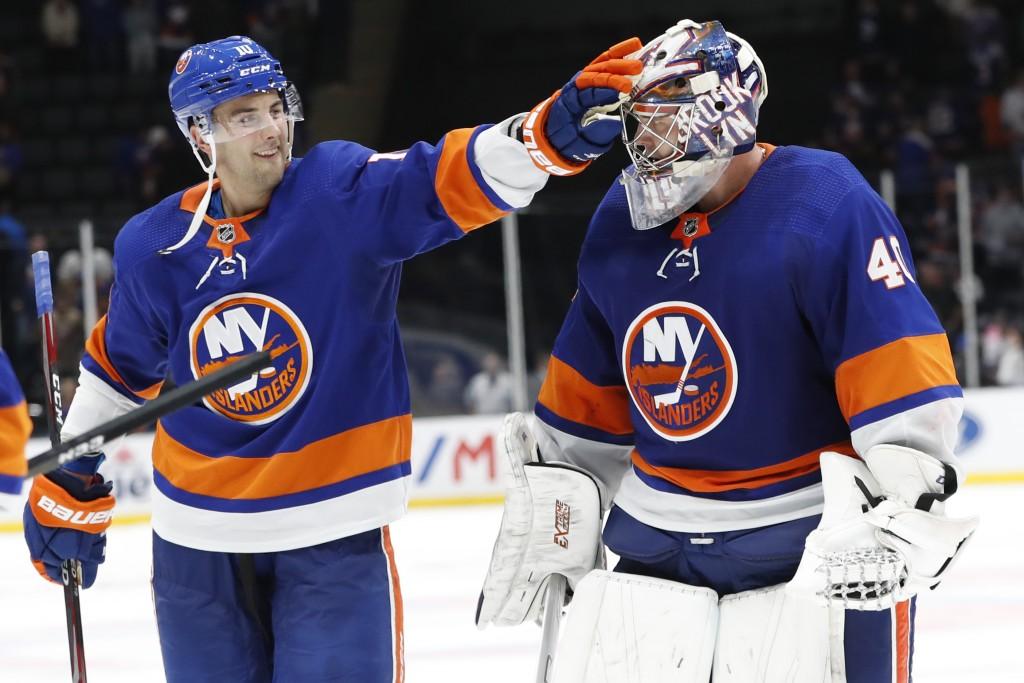 New York Islanders center Derick Brassard (10) celebrates with goaltender Semyon Varlamov (40) after the Islanders defeated the Florida Panthers 3-2, ...