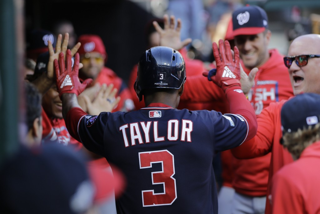 Washington Nationals' Michael A. Taylor is congratulated after hitting a home run during the third inning of Game 2 of the baseball National League Ch...