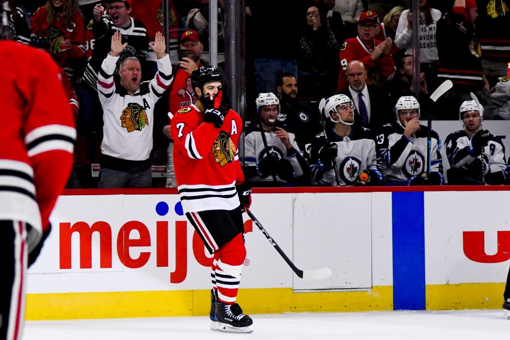Chicago Blackhawks defenseman Brent Seabrook (7) celebrates after he scores against the Winnipeg Jets during the first period of an NHL hockey game Sa...