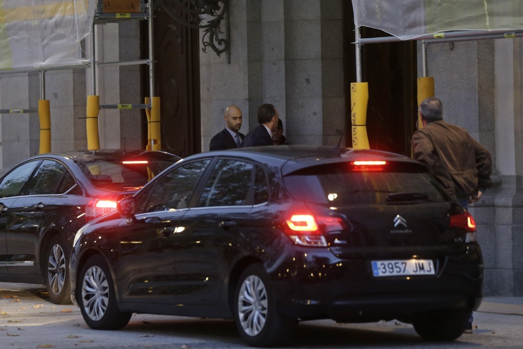 Supreme Court judge Manuel Marchena centre arrives at the court in Madrid Spain Monday Oct. 14 2019. Spain's Supreme Court is set to rule on a