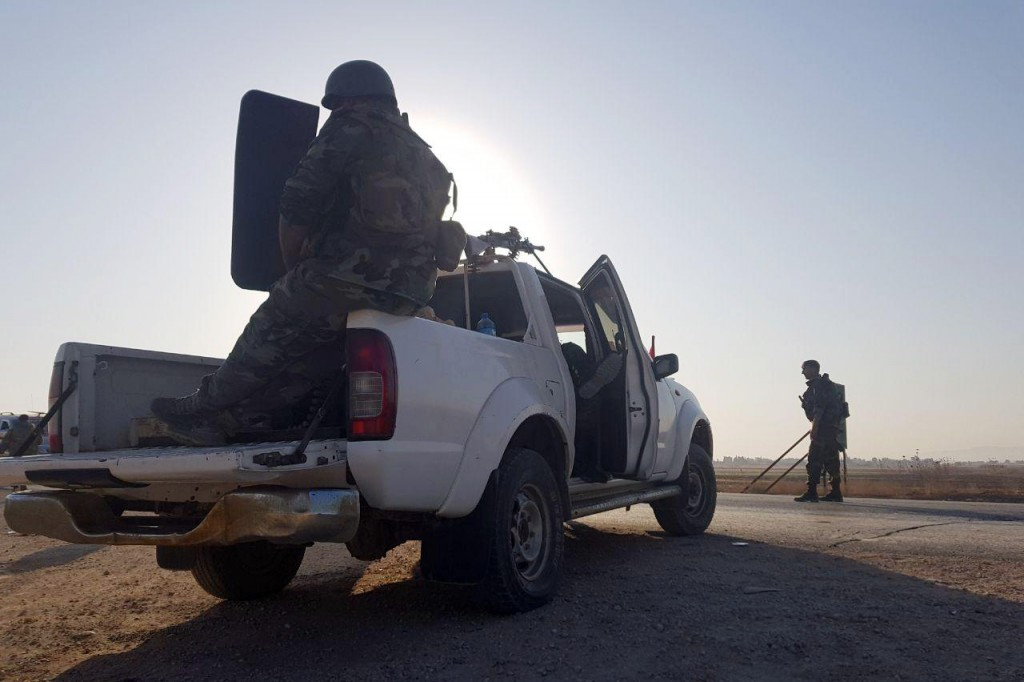 In this photo released by the Syrian official news agency SANA, Syrian troops deploy in the northern town of Tal Tamr, Monday, Oct 14, 2019. The move ...