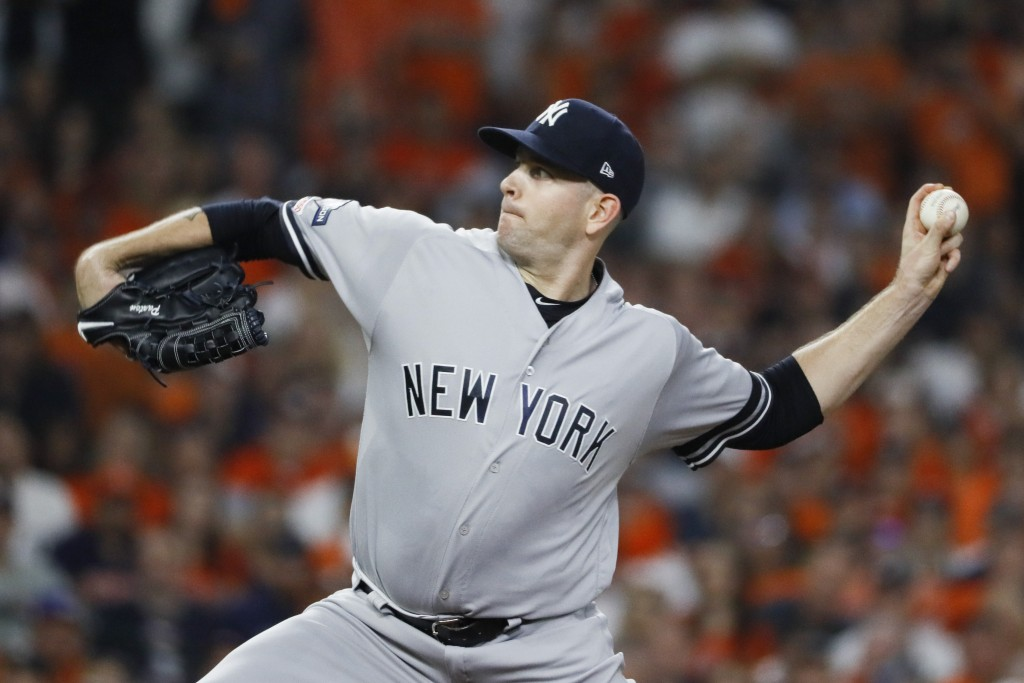 New York Yankees starting pitcher James Paxton throws against the Houston Astros during the first inning in Game 2 of baseball's American League Champ...