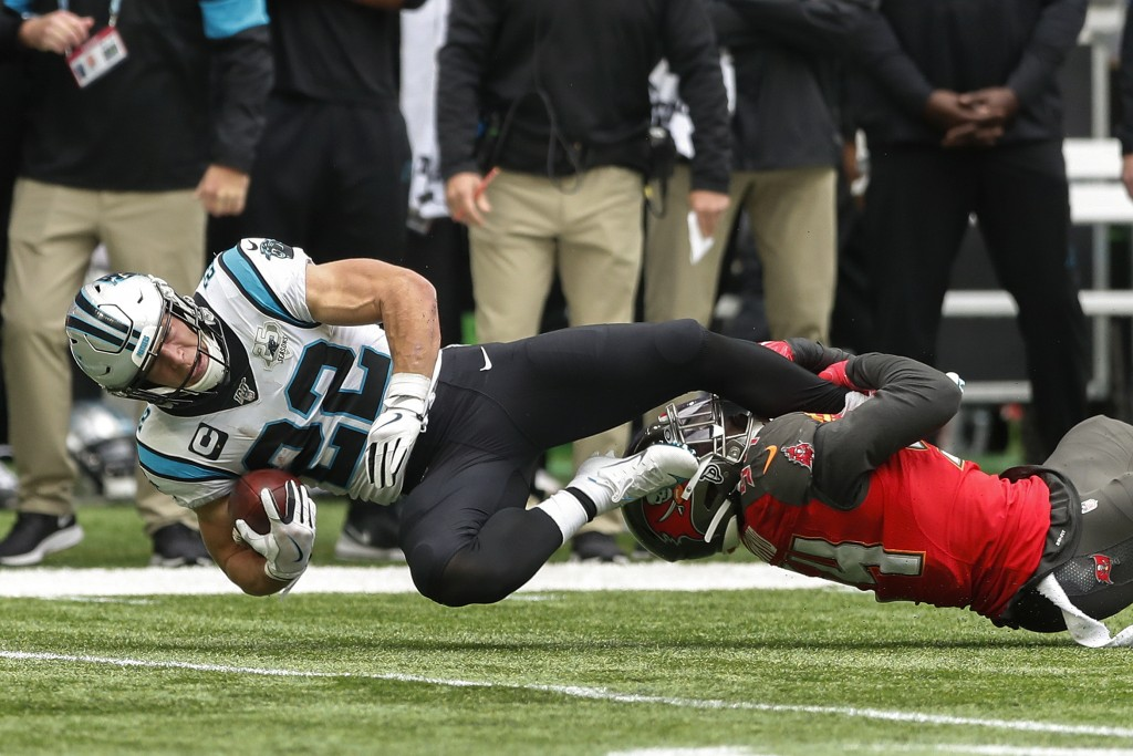 Carolina Panthers running back Christian McCaffrey (22) is tackled by Tampa Bay Buccaneers strong safety Darian Stewart (24) during the first quarter ...