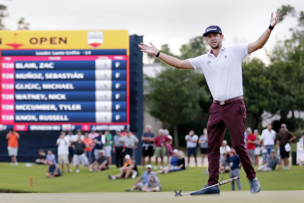 Lanto Griffin drops his putter and throws his arms up after sinking his final putt to win the Houston Open golf tournament Sunday, Oct, 13, 2019, in H...