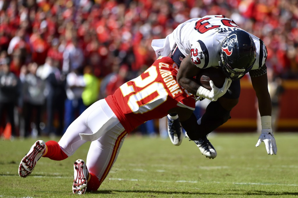 Kansas City Chiefs cornerback Morris Claiborne (20) tackles Houston Texans running back Carlos Hyde (23) during the first half of an NFL football game...