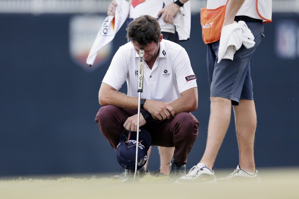Lanto Griffin cries as he squats and rests his head on his putter after winning the Houston Open golf tournament Sunday, Oct, 13, 2019, in Houston. (A...