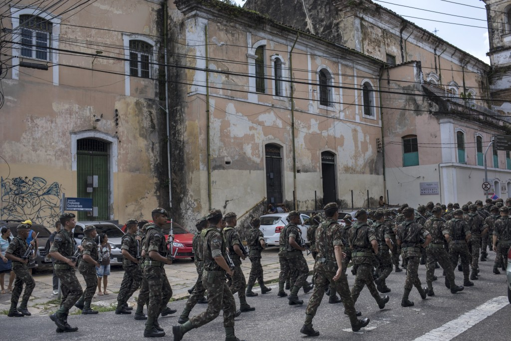 In this Sept. 7, 2019 photo, military police parade near the Ver-o-Peso riverside market in Belém, Brazil. The city is the capital and largest city of...