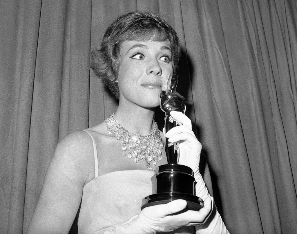 "FILE - This April 6, 1965 file photo shows actress Julie Andrews holding her best actress Oscar for ""Mary Poppins"" in Santa Monica, Calif. Andrews rel..."
