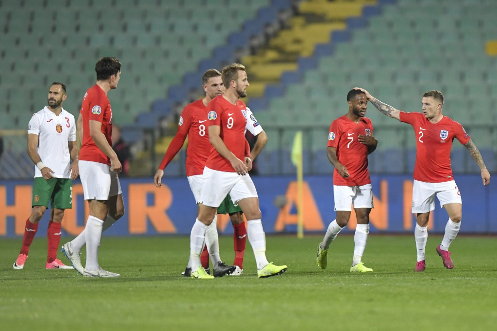 England's Raheem Sterling, second right, celebrates after scoring his side's fifth goal during the Euro 2020 group A qualifying soccer match between B