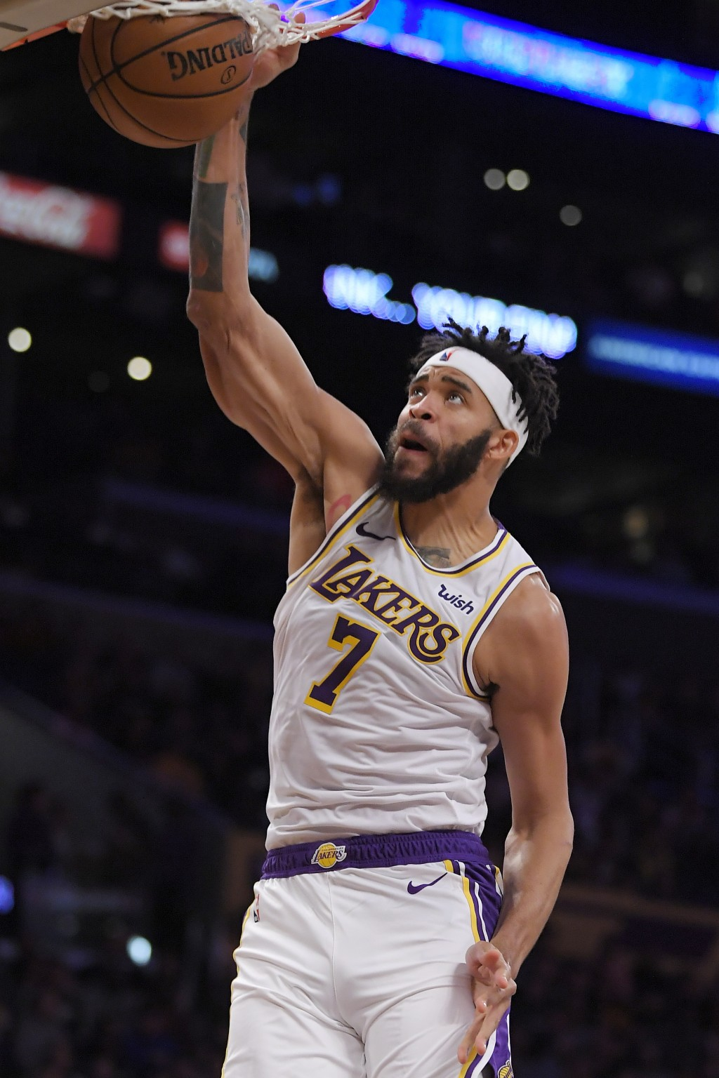 Los Angeles Lakers center JaVale McGee dunks during the first half of a preseason NBA basketball game against the Golden State Warriors, Monday, Oct. ...