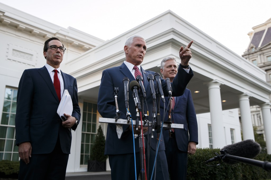 Vice President Mike Pence, with Treasury Secretary Steven Mnuchin, left, and national security adviser Robert O'Brien, speaks to reporters outside the...