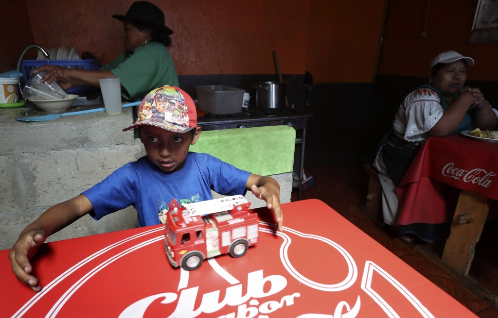 A child plays with a fire engine at a restaurant that reopened for business as Ecuadorians returned to a semblance of normality after nearly two weeks...