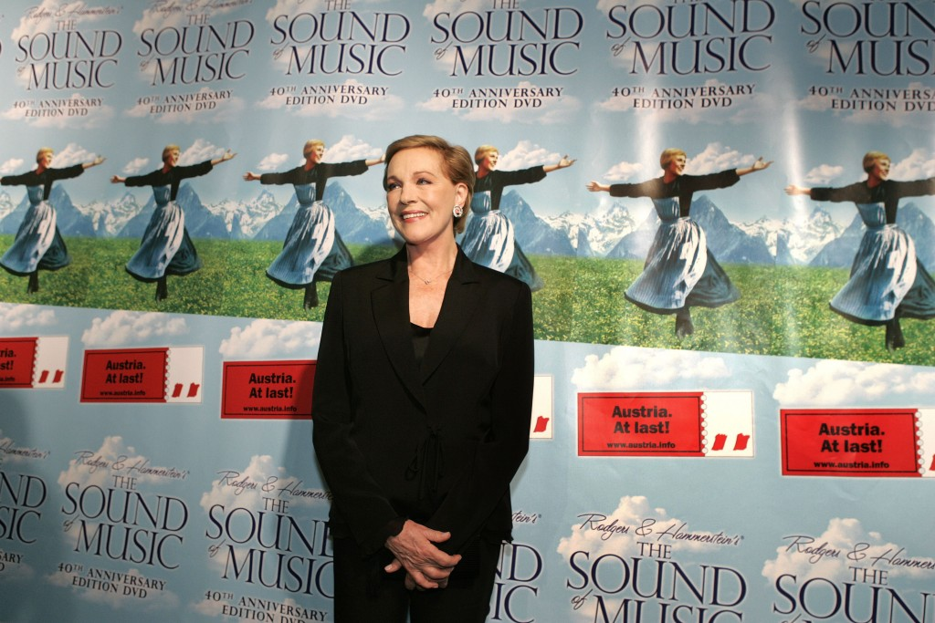 FILE - This Nov. 10, 2005 file photo shows actress Julie Andrews posing in front of posters for the 40th anniversary special edition DVD release party...