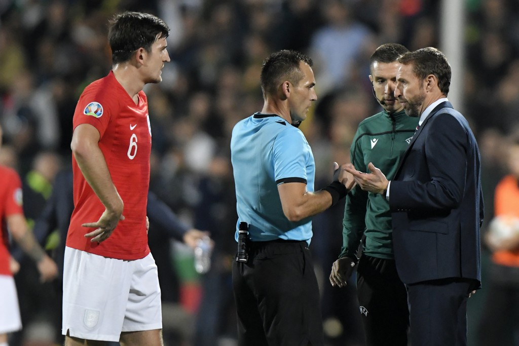 England manager Gareth Southgate, right, speaks with Referee Ivan Bebek during the Euro 2020 group A qualifying soccer match between Bulgaria and Engl