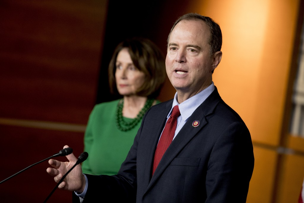 Rep. Adam Schiff, D-Calif., Chairman of the House Intelligence Committee, right, accompanied by House Speaker Nancy Pelosi of Calif., left, speaks abo...