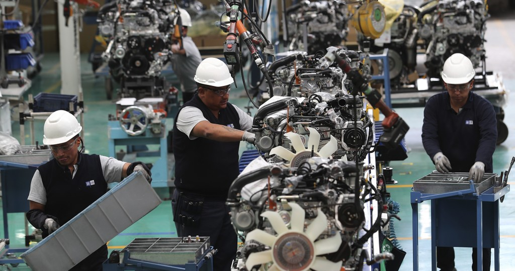 Workers assemble cars at the General Motors plant in Quito, Ecuador, Tuesday, Oct. 15, 2019. The recent national strike has left President Lenin Moren...