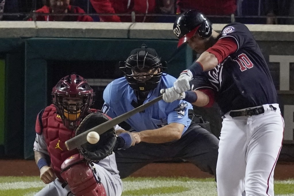 Washington Nationals' Yan Gomes hits a two-run scoring single during the first inning of Game 4 of the baseball National League Championship Series ag