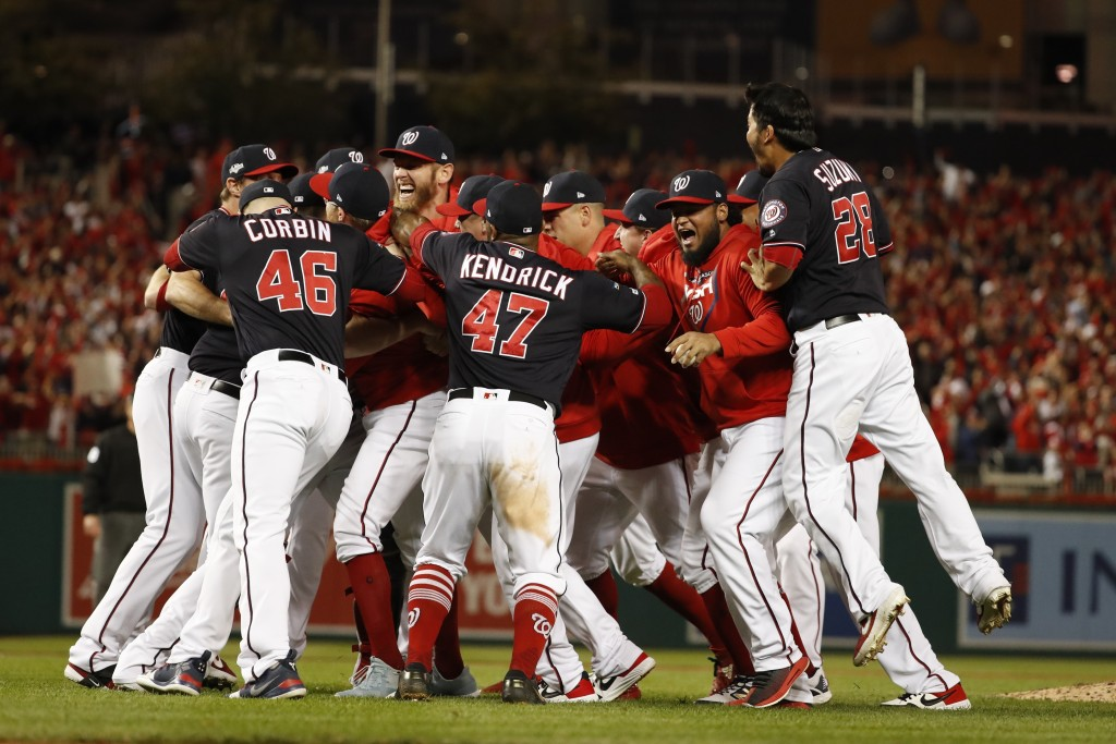The Washington Nationals celebrate after Game 4 of the baseball National League Championship Series Tuesday, Oct. 15, 2019, in Washington. The Nationa