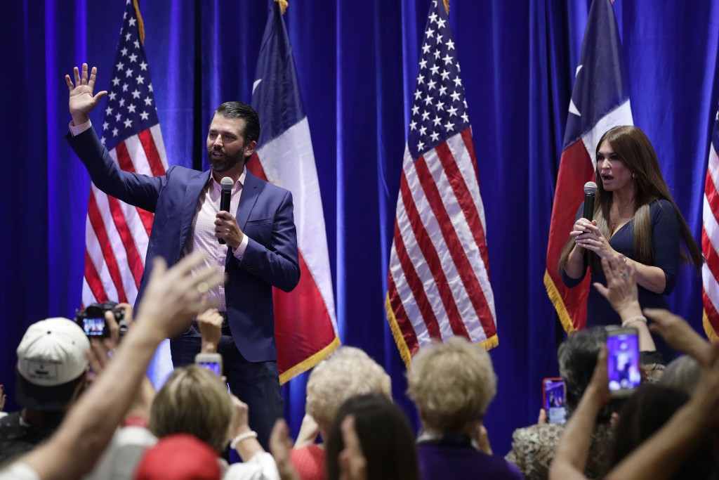 Donald Trump, Jr., left, and Trump campaign senior adviser Kimberly Guilfoyle, right, speak to supporters of President Donald Trump during a panel dis...