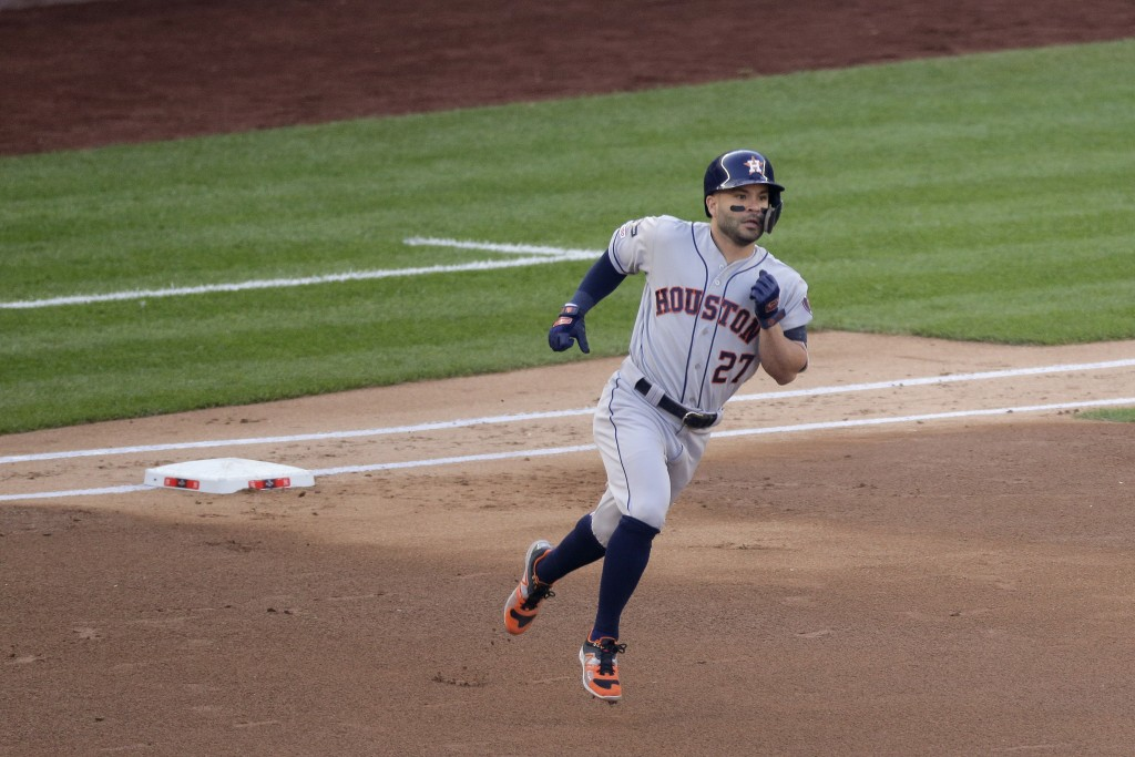 Houston Astros' Jose Altuve (27) rounds the bases after hitting a solo home run against the New York Yankees during the first inning of Game 3 of base...