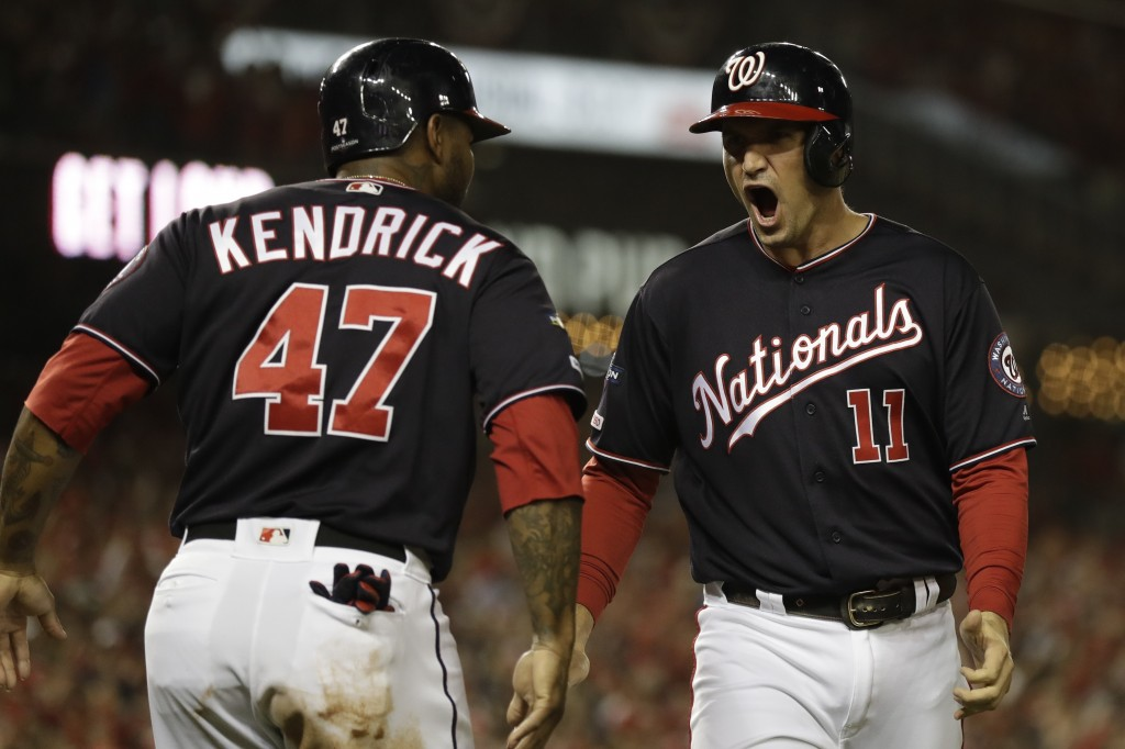 Washington Nationals' Ryan Zimmerman reacts with Howie Kendrick after scoring during the first inning of Game 4 of the baseball National League Champi