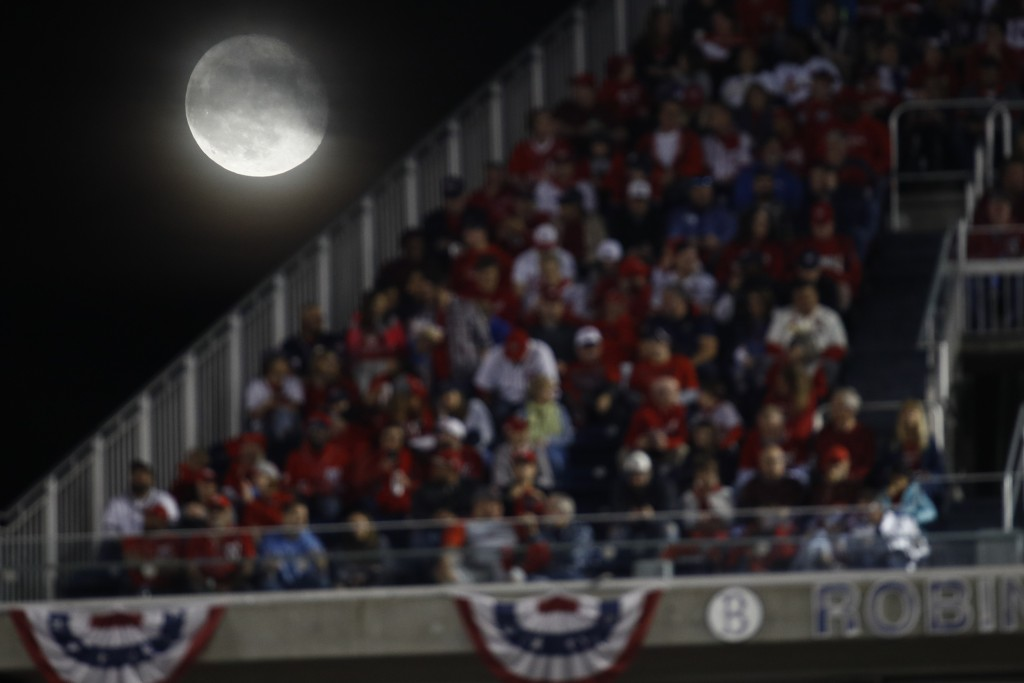 The moon is seen over Nationals Park during the third inning of Game 4 of the baseball National League Championship Series between the St. Louis Cardi