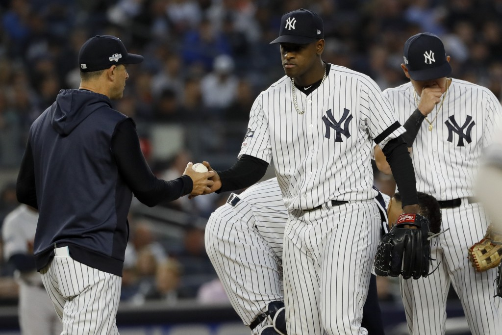 New York Yankees starting pitcher Luis Severino is taken out of the game by manager Aaron Boone during the fifth inning in Game 3 of baseball's Americ...