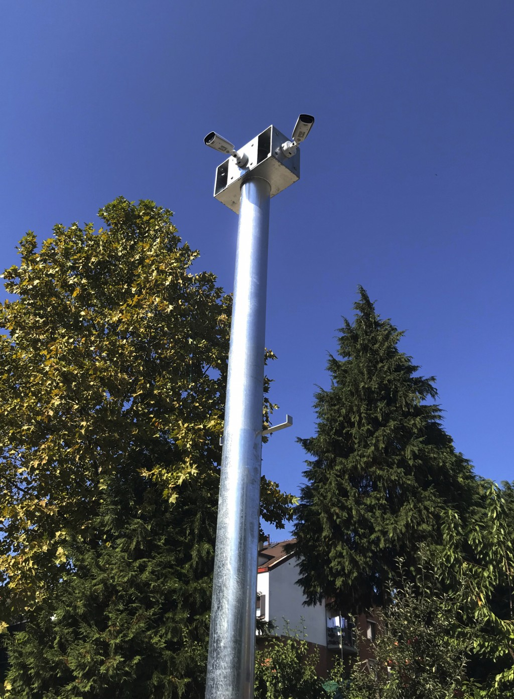 In this Oct 2, 2019, photo, cameras hang from a pole in Belgrade, Serbia. A video surveillance system with facial recognition by Chinese tech giant Hu...