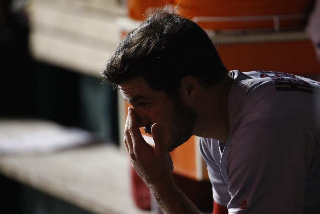 St. Louis Cardinals starting pitcher Dakota Hudson sits on the bench after being relieved during the first inning of Game 4 of the baseball National L