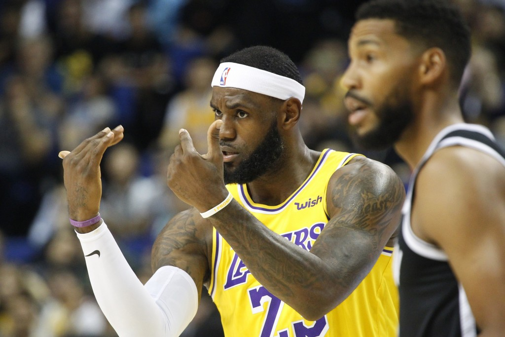 Los Angeles Lakers' Lebron James gestures during a preseason NBA game against the Brooklyn Nets in Shanghai, China, Thursday, Oct. 10, 2019. All of th...